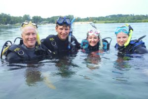 Young and Old Scuba Diving at Pearl Lake